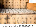old wooden chair with spikes... | Shutterstock . vector #1228096813