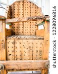 old wooden chair with spikes... | Shutterstock . vector #1228096816