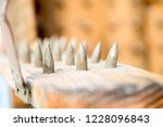old wooden chair with spikes... | Shutterstock . vector #1228096843