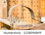 old wooden chair with spikes... | Shutterstock . vector #1228096849
