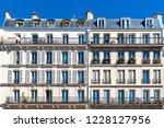 paris  beautiful house in... | Shutterstock . vector #1228127956