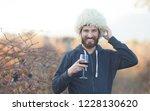 portrait of beardman with wine... | Shutterstock . vector #1228130620