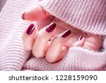 red wine color manicure on girl ... | Shutterstock . vector #1228159090