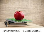 stack of books on table at... | Shutterstock . vector #1228170853
