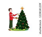 boy  man  decorates the... | Shutterstock .eps vector #1228181239