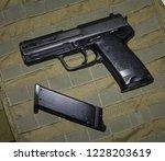 airsoft hand gun usp p8 and its ... | Shutterstock . vector #1228203619
