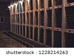 bottles of wine in the wine...   Shutterstock . vector #1228214263