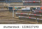 trains at railroad yard at... | Shutterstock . vector #1228227193