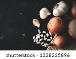 onions and garlic on top of the ... | Shutterstock . vector #1228235896
