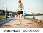 photo from back of running... | Shutterstock . vector #1228236820