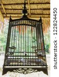Thai style wooden bird cage - stock photo
