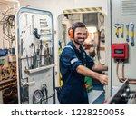 marine engineer officer in... | Shutterstock . vector #1228250056