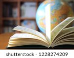 close up of books opened on... | Shutterstock . vector #1228274209