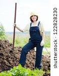 female farmer works with manure ...