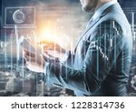 businessman with a glowing...   Shutterstock . vector #1228314736
