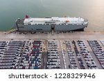 Aerial view Ro-Ro Ship of business logistic sea freight, New Cars produced by year up in the port for Cargo ship and Cargo import-export around in the world. cargo ship  - stock photo
