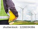 engineer worker at wind turbine ...   Shutterstock . vector #1228334386