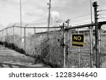 closed factory due to trade ... | Shutterstock . vector #1228344640