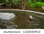 image of asian boy swimming in... | Shutterstock . vector #1228350913