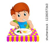 vector illustration of a young... | Shutterstock .eps vector #1228357363