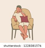 a man sitting comfortably in a... | Shutterstock .eps vector #1228381576
