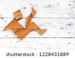 tangram puzzle in falling man... | Shutterstock . vector #1228431889