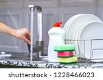 different clean plates in dish... | Shutterstock . vector #1228466023
