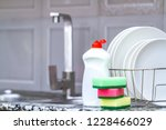 different clean plates in dish... | Shutterstock . vector #1228466029