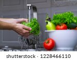 woman washing vegetables in the ... | Shutterstock . vector #1228466110