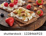 sandwich with nuts and berrie... | Shutterstock . vector #1228466923