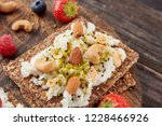 sandwich with nuts and berrie... | Shutterstock . vector #1228466926