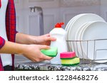 different clean plates in dish... | Shutterstock . vector #1228468276