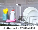different clean plates in dish... | Shutterstock . vector #1228469380
