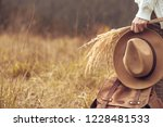 female hand holds hat and... | Shutterstock . vector #1228481533
