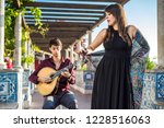 band performing traditional... | Shutterstock . vector #1228516063