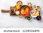 fried egg with tomatoes in... | Shutterstock . vector #1228526890