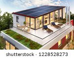 solar panels on the roof of the ... | Shutterstock . vector #1228528273