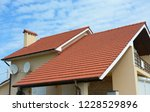 modern house with chimney  red... | Shutterstock . vector #1228529896