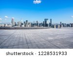 empty square with city skyline... | Shutterstock . vector #1228531933