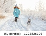 child walking at winter park | Shutterstock . vector #1228536103