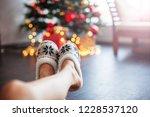 legs in slippers on christmas... | Shutterstock . vector #1228537120