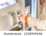 hand of woman paying car...   Shutterstock . vector #1228549636