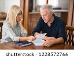 couple calculating their... | Shutterstock . vector #1228572766
