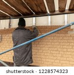 installing siding on the wall... | Shutterstock . vector #1228574323