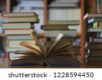 close up of old book opened on... | Shutterstock . vector #1228594450