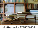 close up of old book opened on... | Shutterstock . vector #1228594453