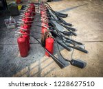 red tank of fire extinguisher.... | Shutterstock . vector #1228627510