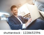 the young man chatting with... | Shutterstock . vector #1228652596