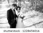 newlyweds read a congratulatory ... | Shutterstock . vector #1228656016