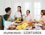 happy big asian family eating... | Shutterstock . vector #1228710826